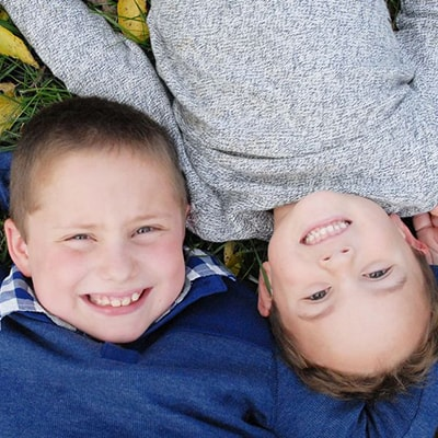 Actual patients, Ayden and Chase, lying down outside