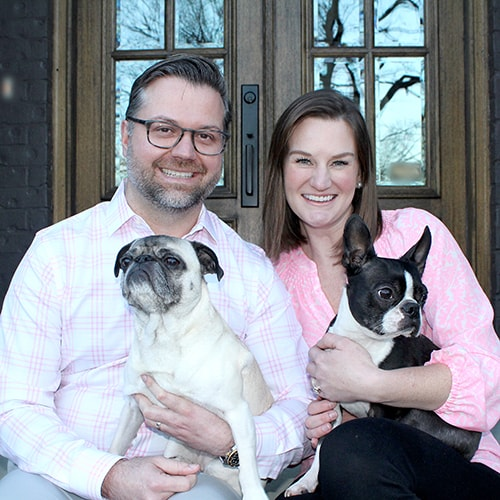 Dr. Brittany with her husband and adorable Boston Terriers